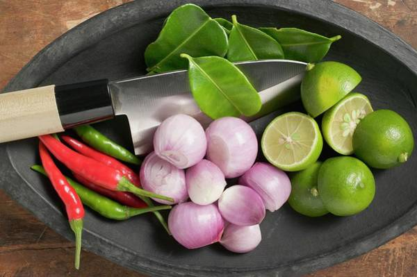 Vegies Photograph - A Bowl Of Limes, Lime Leaves, Chillis And Onions by Eising Studio - Food Photo and Video
