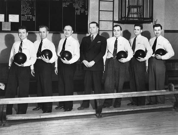 Ten Pin Bowling Wall Art - Photograph - A Bowling Team With Balls by Underwood Archives