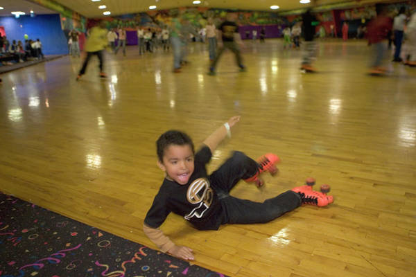 Wall Art - Photograph - A Boy Learning To Roller Skate by Peter Essick