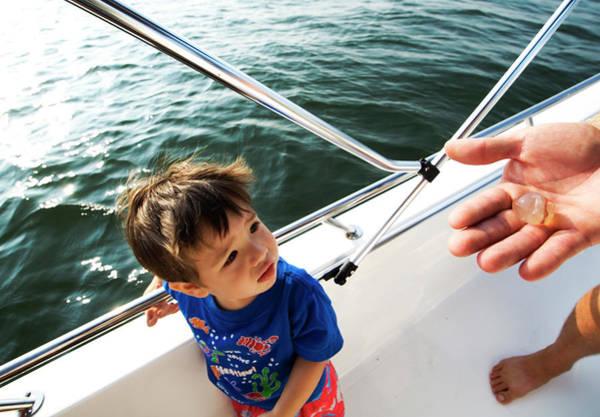 Kiawah Island Photograph - A Boy Looks Fearfully At A Jellyfish by Andrew Kornylak
