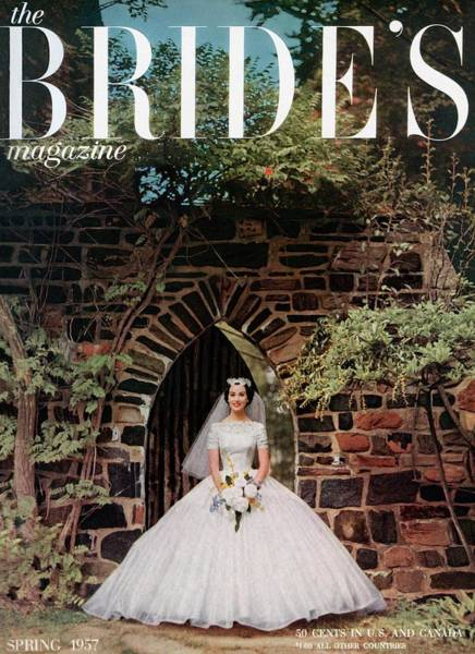Wall Photograph - A Bride In Front Of Stone Gate by Carmen Schiavone