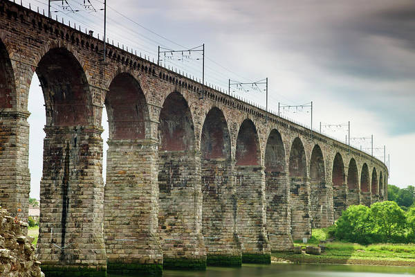 Berwick Upon Tweed Photograph - A Bridge With Arches And Power Lines by John Short