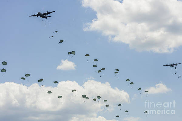 Skydiver Photograph - A C-130 Hercules Drop U.s. Army by Rob Edgcumbe