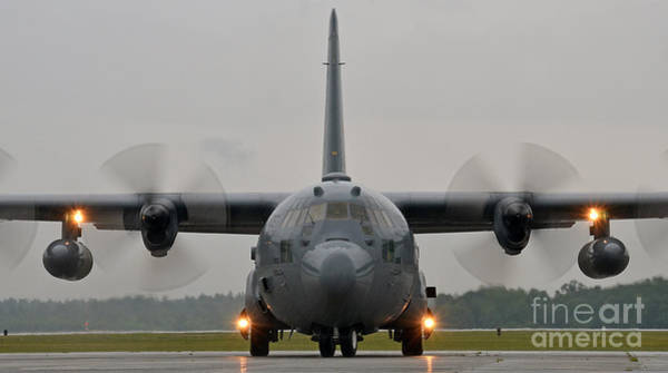 C 130 Photograph - A C-130 Hercules Taxis On The Flight Line by Celestial Images