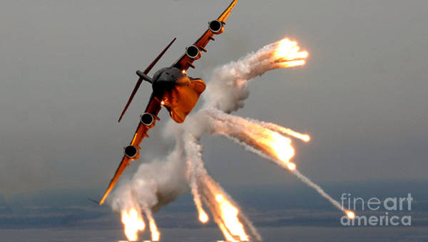 Uss George Washington Wall Art - Photograph - A C-17 Globemaster IIi Releases Flares by Celestial Images