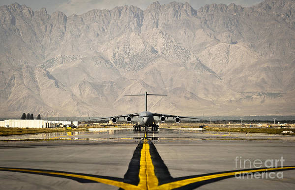 C-17 Photograph - A C-17 Globemaster IIi Taxis by Stocktrek Images