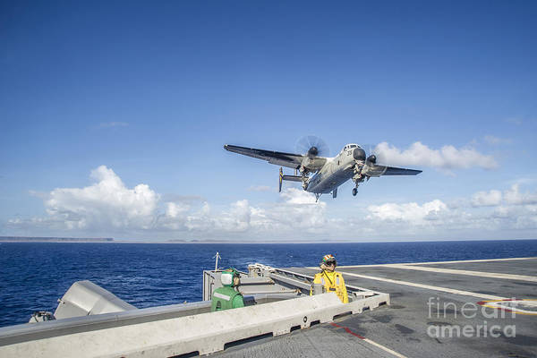 Uss George Washington Wall Art - Photograph - A C-2a Greyhound Carrying Relief by Stocktrek Images