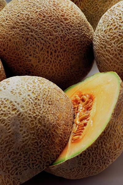 Fresh Photograph - A Cantaloupe Sliced In Half by Romulo Yanes