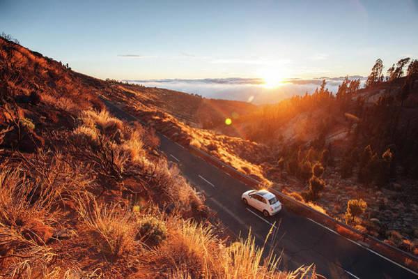 Niebla Wall Art - Photograph - A Car Runs On An Empty Mountain Road by Sergio Villalba