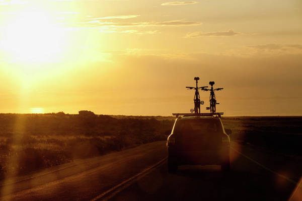 Back Road Photograph - A Car With Two Bikes On Top Drives by Ryan Rombough