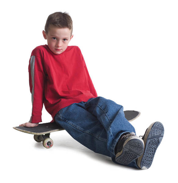 A Caucasian Boy In Jeans And A Red Sweater Sits On His Skateboard And Smiles Slightly Art Print by Photodisc