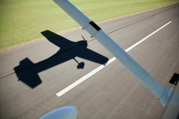 Taking Off Photograph - A Cessna Light Aircraft Taking Off. The by Richard Du Toit