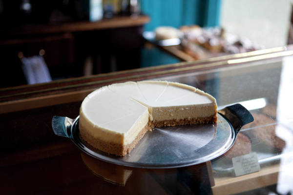 Slice Photograph - A Cheesecake Cut Into Slices On A by Halfdark