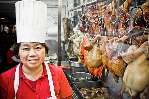 Wall Art - Photograph - A Chinese Cook By Row Of Roasted Ducks by Dan Chung