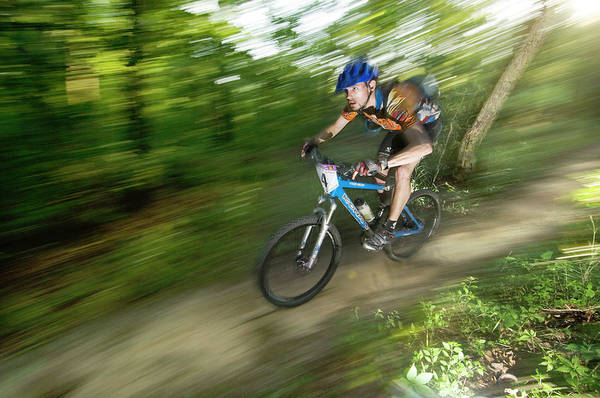 Conyers Photograph - A Competitor Races Through The Woods by Andrew Kornylak