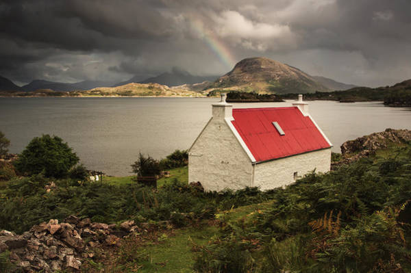 Wall Art - Photograph - A Cottage With A Red Roof On The Water by John Short