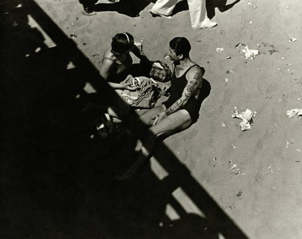 Outdoor Photograph - A Couple At Coney Island by Lusha Nelson
