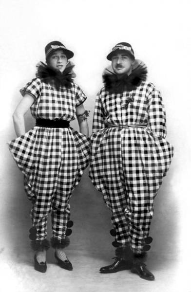 Photograph - A Couple In Amazing Outfits by Underwood Archives