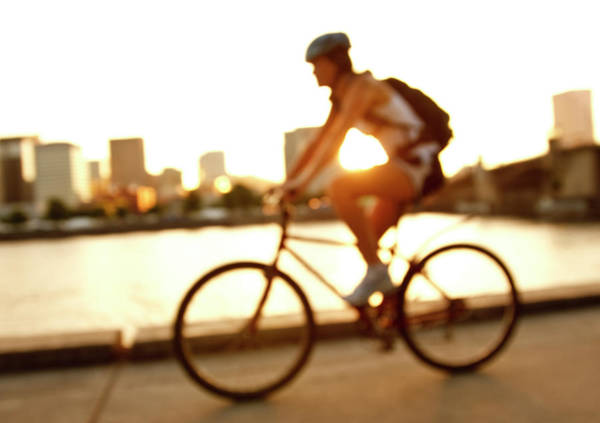 Wall Art - Photograph - A Cyclist Riding Along The Water by Jordan Siemens