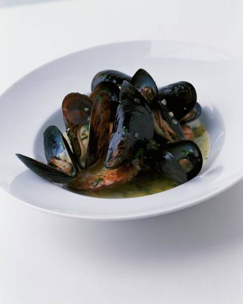 Dine Photograph - A Dish Of Mussels by Romulo Yanes