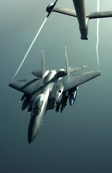 Sharpshooter Wall Art - Photograph - A F-15e Disengaging From A Kc-10 by Celestial Images