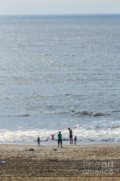 Wall Art - Photograph - A Family Enjoys The Early Morning Atlantic Beach At Ocean City Md  by William Kuta