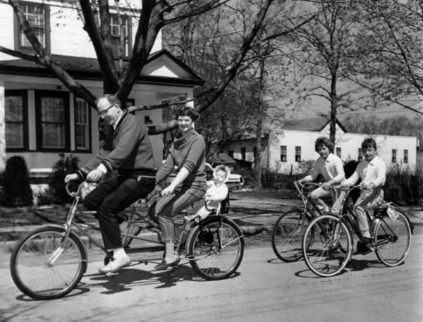 Outing Photograph - A Family On A Bicycle Ride by Underwood Archives