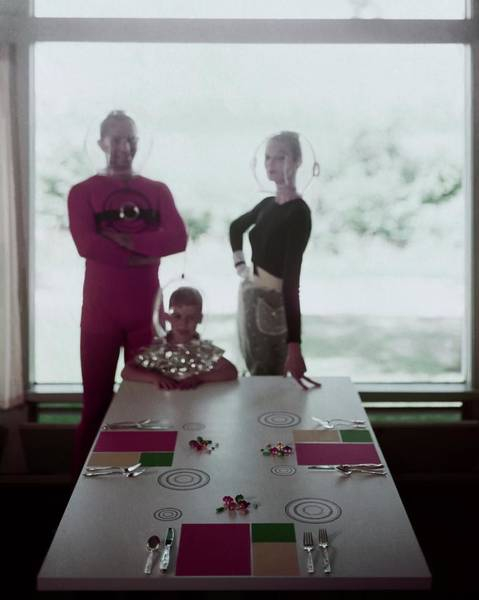 Cutlery Photograph - A Family Posing By A Dining Table by Otto Maya