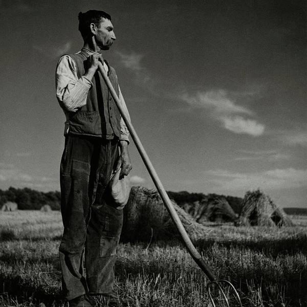 Outdoor Photograph - A Farmer Holding A Pitchfork by Roger Schall