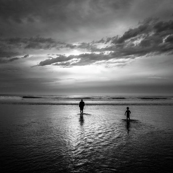 Rockaway Photograph - A Father And Son Wade Into The Pacific by Christopher Kimmel