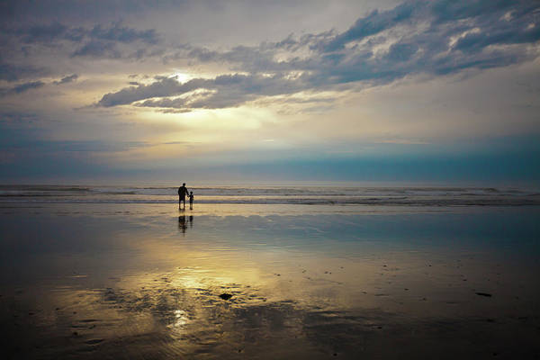 Rockaway Photograph - A Father And Son Watch The Sunset While by Christopher Kimmel