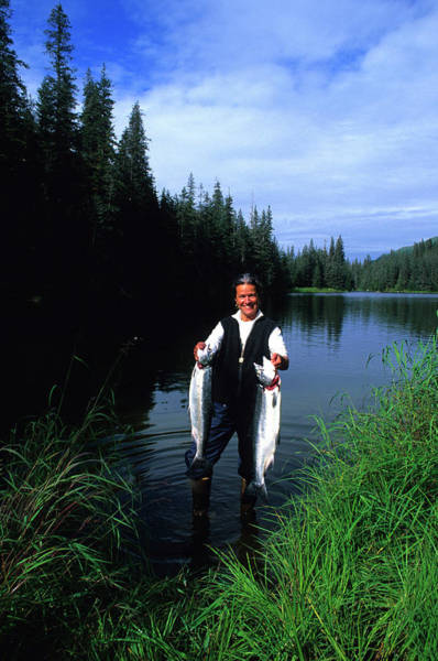 Wall Art - Photograph - A Female Angler Holds Two Silver Coho by Stephen Gorman