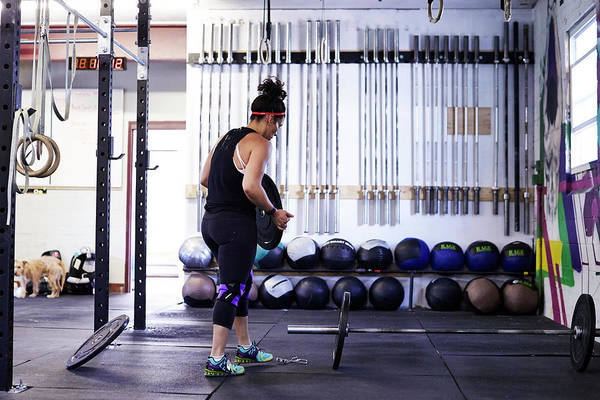 Dog Training Photograph - A Female Athlete Trains In A Crossfit by Josh Campbell