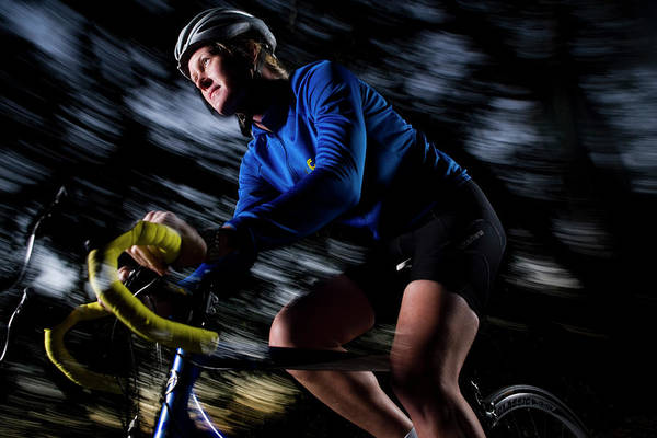Wall Art - Photograph - A Female Cyclist In A Blue Jersey by Lamar Standish