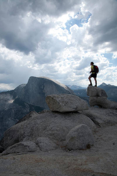 Wall Art - Photograph - A Female Hiker On Granite Boulders by Adam Clark