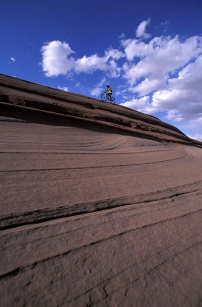 It Professional Photograph - A Female Mountain Biker Mountain Biking by Corey Rich