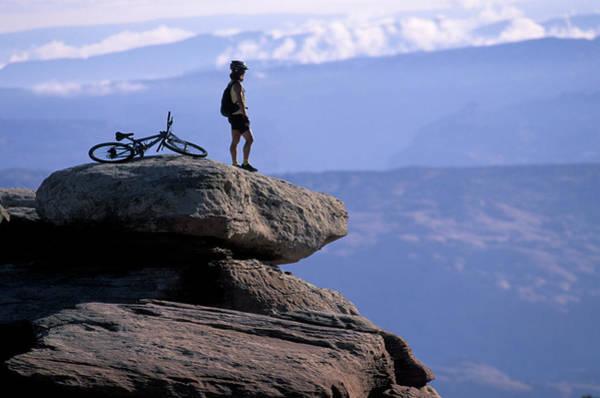 A Female Mountain Biker Stands Art Print