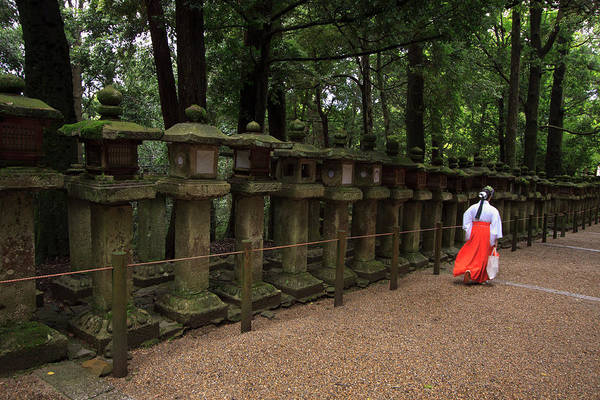 Kansai Wall Art - Photograph - A Female Shrine Attendant Walks by Paul Dymond