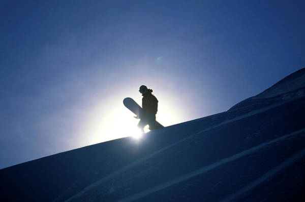 Wall Art - Photograph - A Female Snowboarder Hiking by Corey Rich