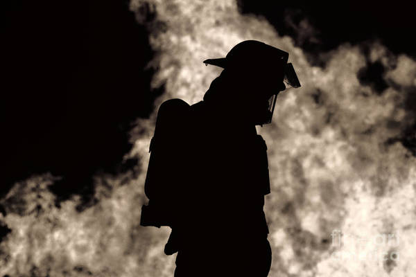 Photograph - A Firefighter by Jim Lepard