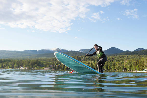 Wetsuit Wall Art - Photograph - A Fit Female Stand Up Paddle Boards by Craig Moore