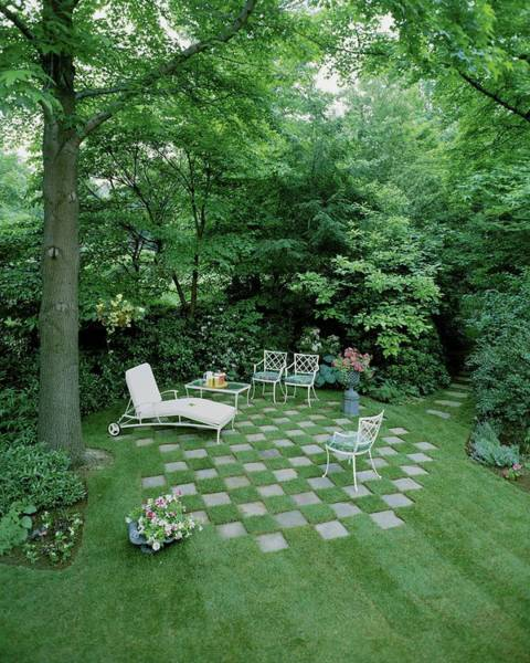 Outdoor Furniture Photograph - A Garden With Checkered Pavement by Pedro E. Guerrero