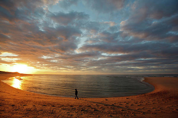 Wall Art - Photograph - A Girl Walks On The Beach A The Sun by Jerry and Marcy Monkman