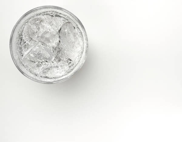 Drinking Glass Photograph - A Glass Of Sparkling Water With Ice by Anthony Bradshaw