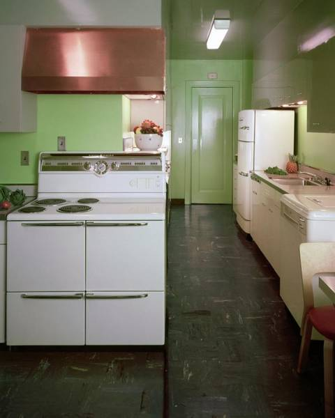 Illuminated Photograph - A Green Kitchen by Constantin Joffe
