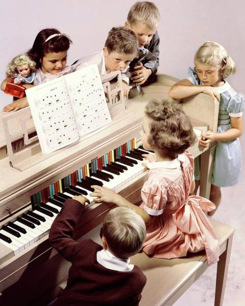 6 Photograph - A Group Of Children At The Piano by Herbert Matter