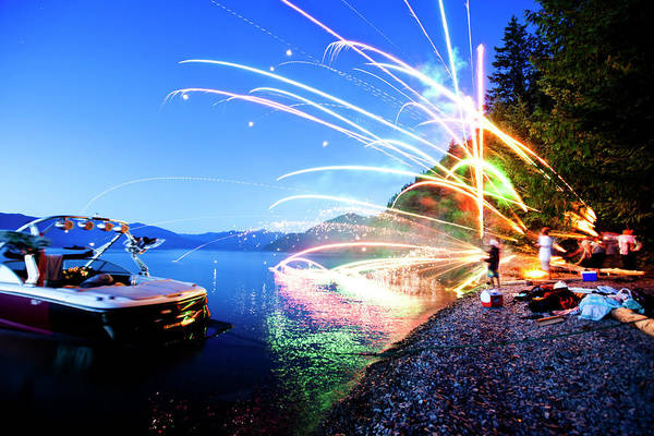 Wall Art - Photograph - A Group Of Friends Light Off Fireworks by Patrick Orton