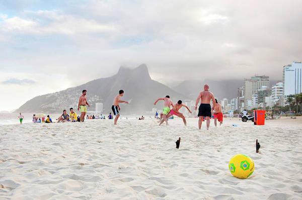Rio De Janeiro Photograph - A Group Of Men Play Soccer On Ipanema by Leslie Parrott