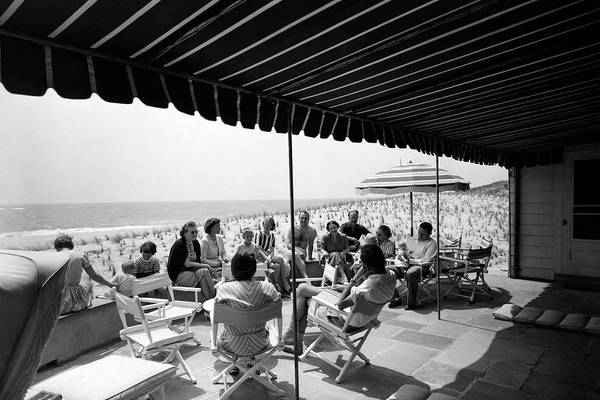 New York State Photograph - A Group Of People On A Terrace Overlooking by Tom Leonard