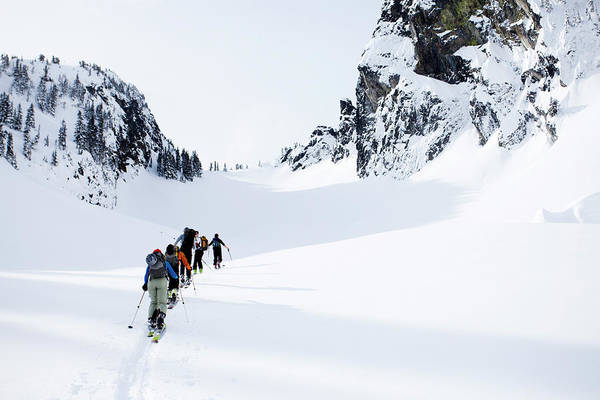 Wall Art - Photograph - A Group Of Skiers In The Backcountry by Michael Hanson